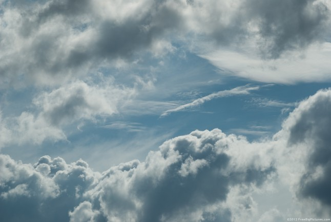 Boiling clouds on a blue background of a sunny sky