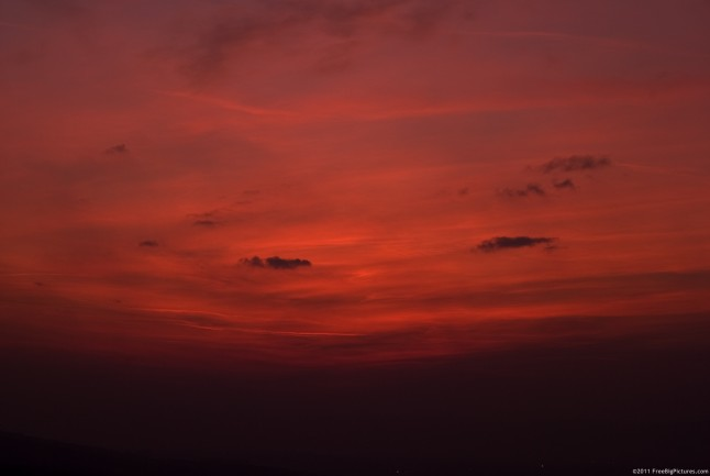 Sky with reddish hues after sunset
